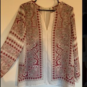 White blouse with tan and pale pink patterns